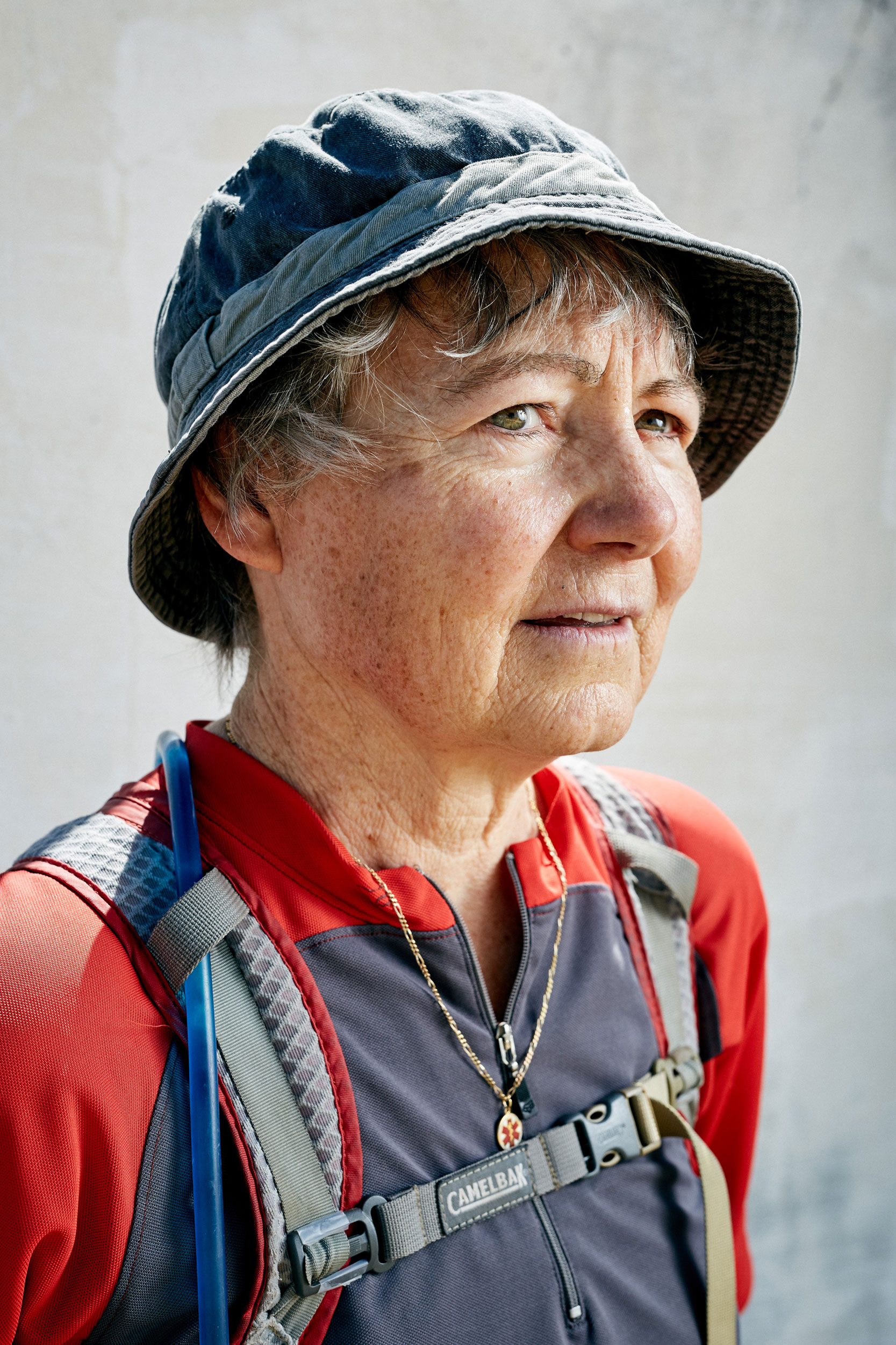 Elderly Camino pilgrim woman with a diabetes necklace taken by documentary portrait photographer Duncan Elliott