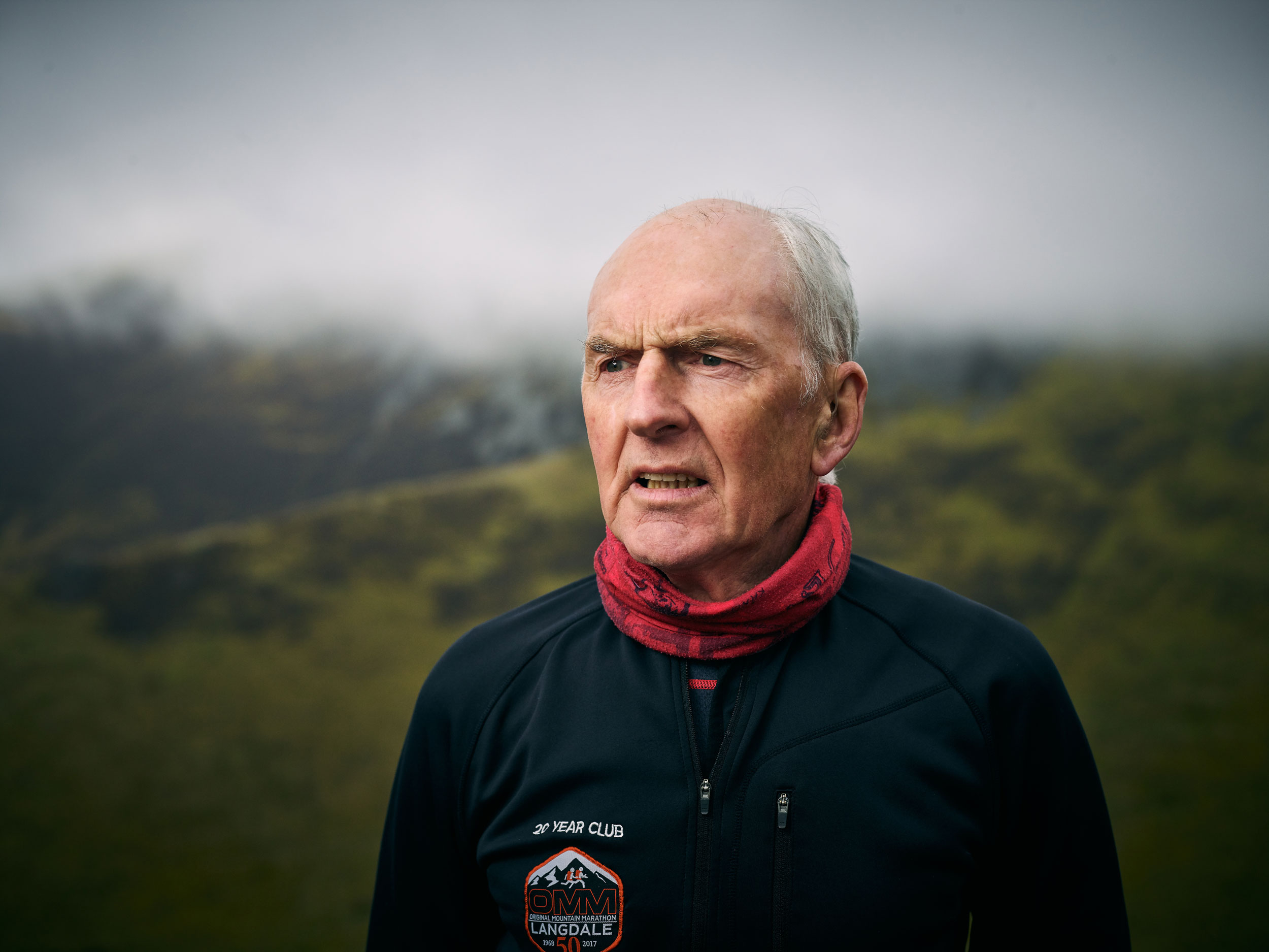 An elderly fell runner looks out over his route taken by documentary portrait photographer Duncan Elliott